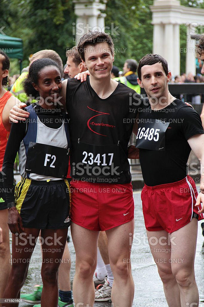 Two Men Pausing With Professional Female Athlete royalty-free stock photo