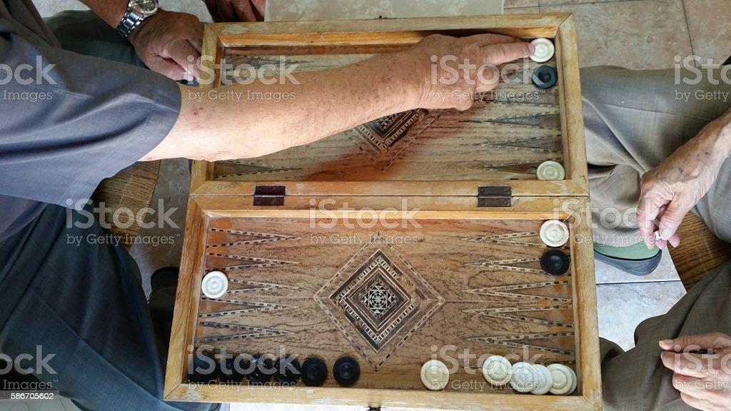 two men playing backgammon stock photo