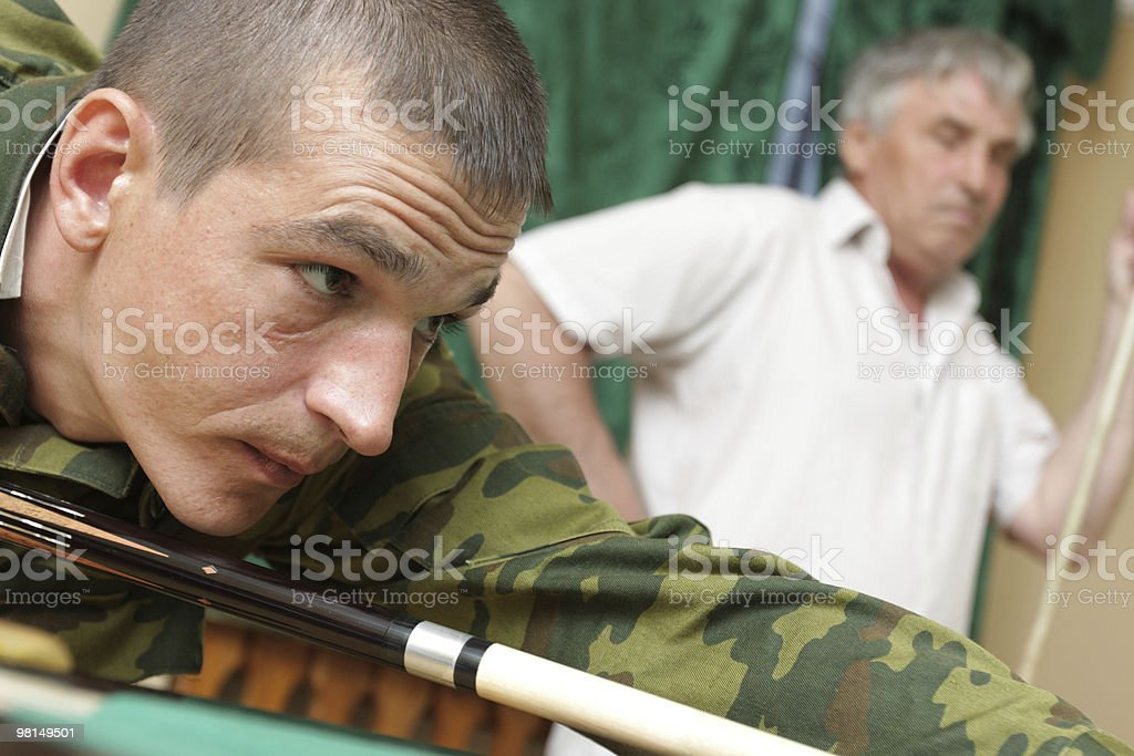 Two men playing billiards royalty-free stock photo