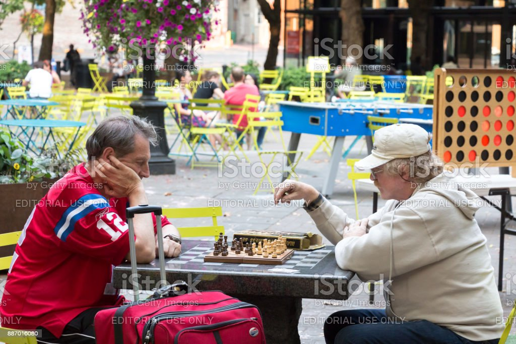 Two men playing chess at Pioneer Square. stock photo