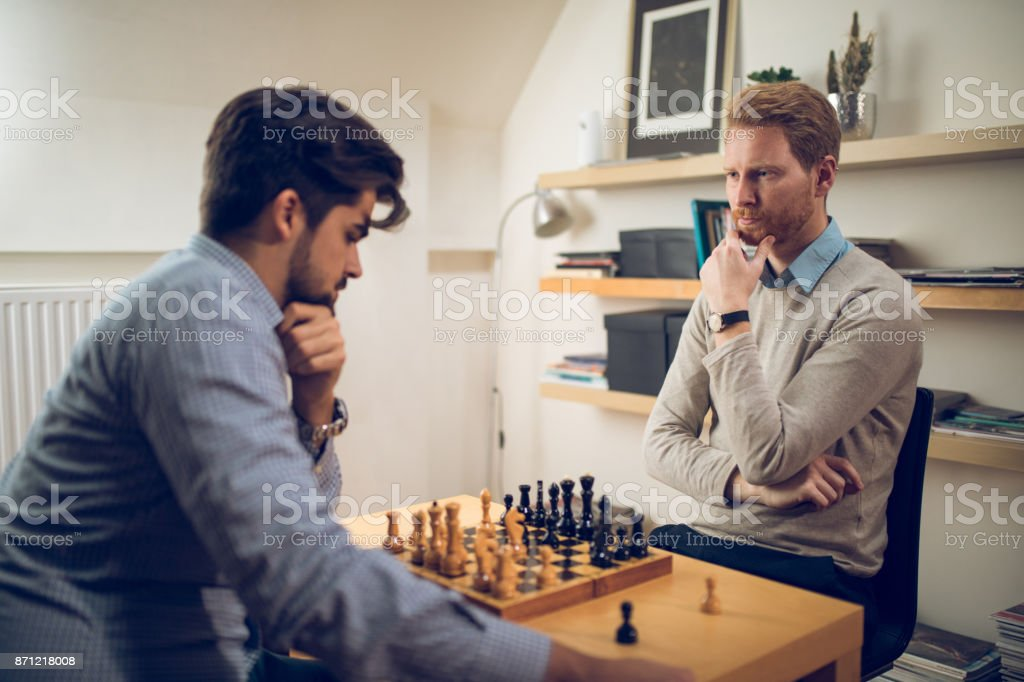 Two men playing chess stock photo