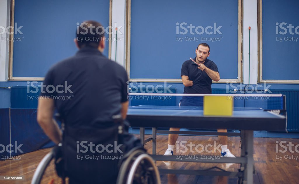 Two men playing table tennis stock photo