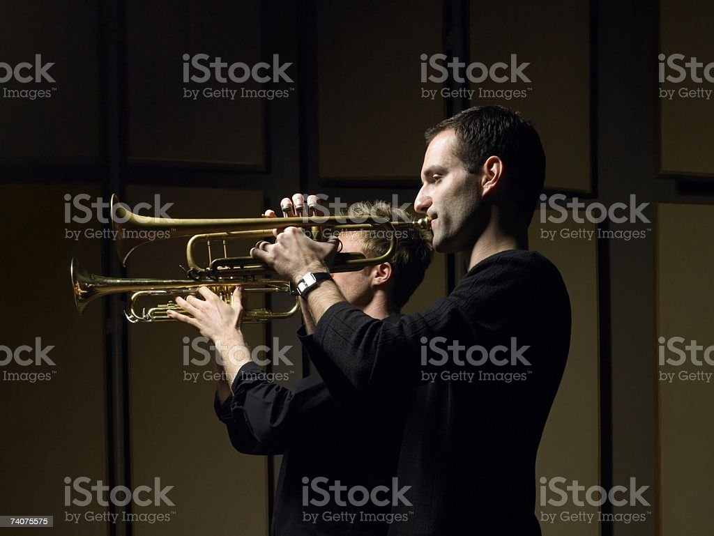 Two men playing trumpets royalty-free stock photo