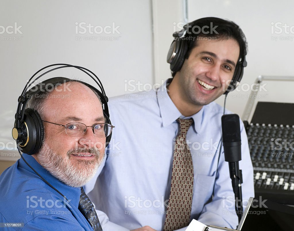 Two Men Podcasting Looking At Camera royalty-free stock photo