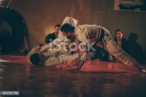 istock Two men practicing martial arts 924252760