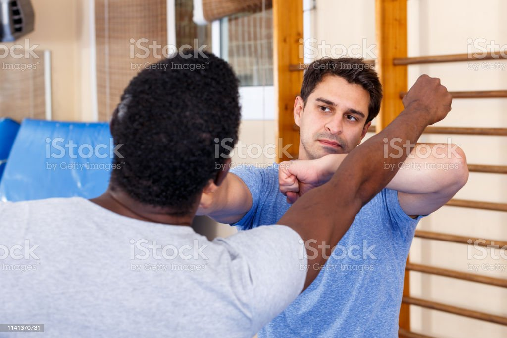 Two Men Practicing Self Defense Techniques Stock Photo Download Image Now Istock