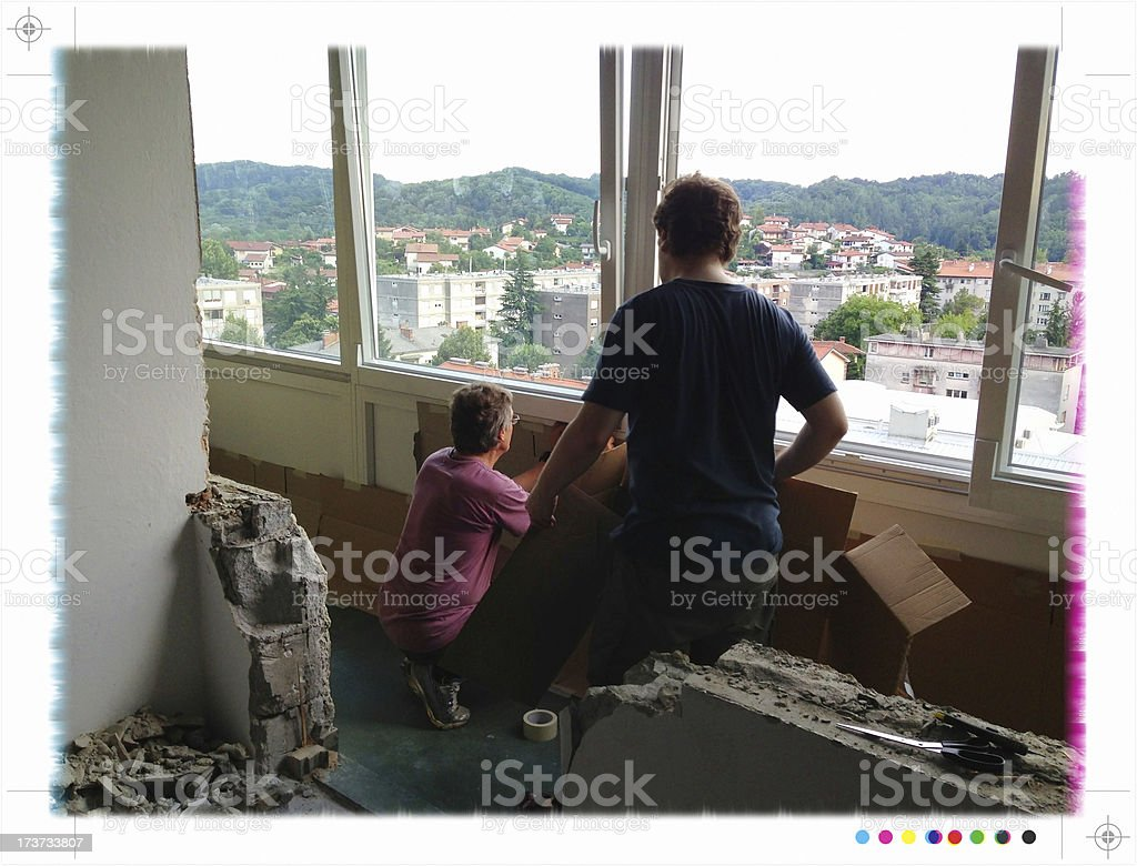 Two men protecting a balcony during home addition. royalty-free stock photo