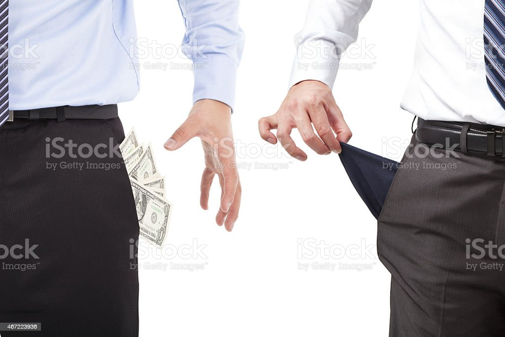 Two men pulling empty and full pocket out of pants stock photo