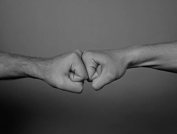Two men punching stock photo