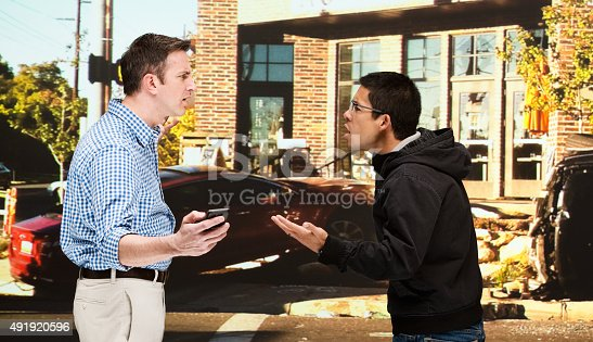 475395935istockphoto Two men quarreling in front of car accident 491920596