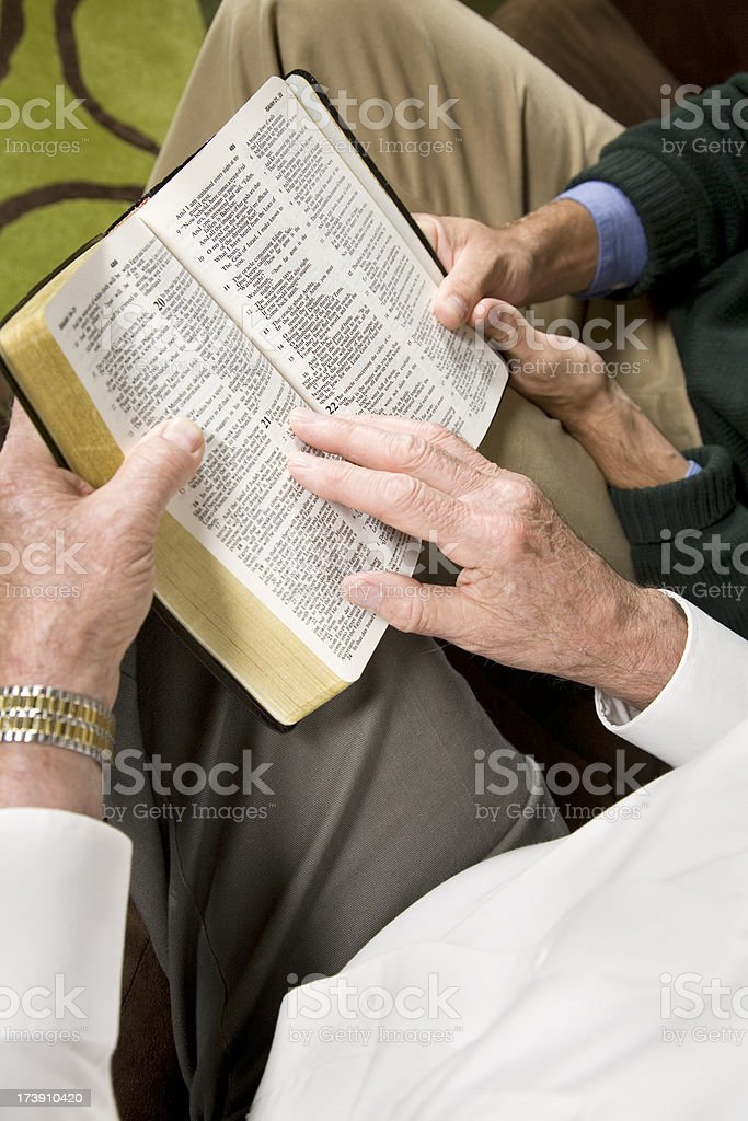 Two Men Reading Scriptures In The Bible Together royalty-free stock photo