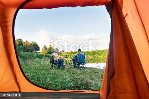 istock Two men relaxing and fishing 1073382314