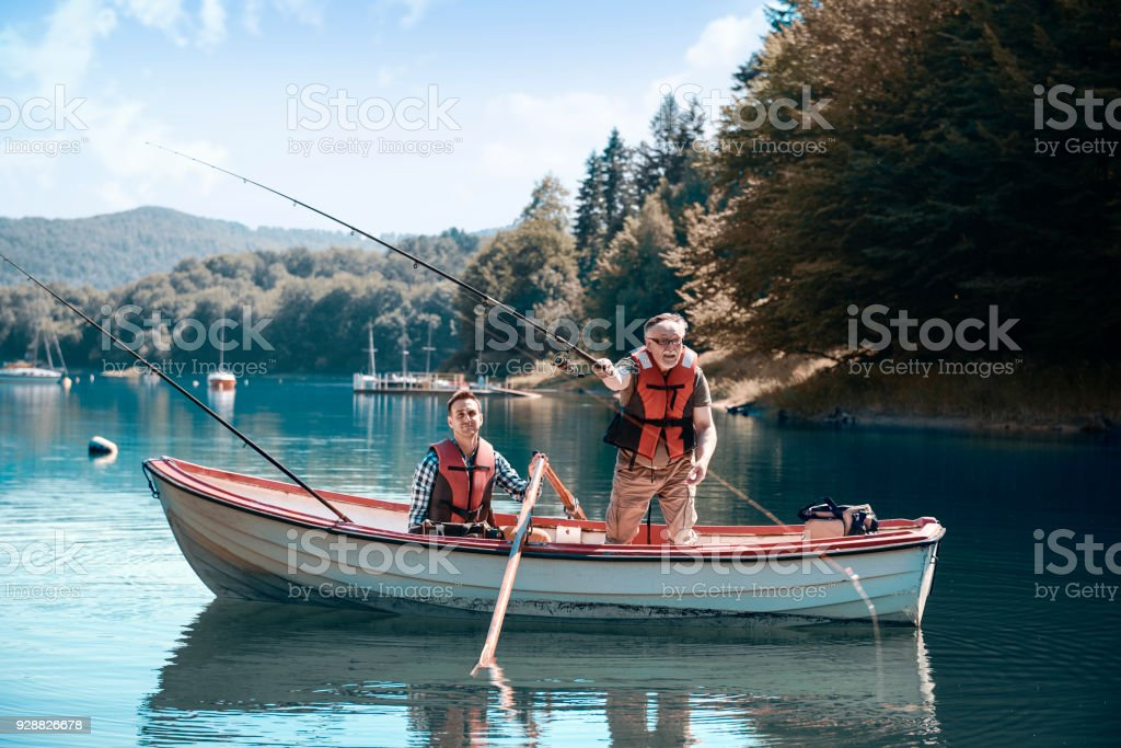 Two men relaxing and fishing stock photo