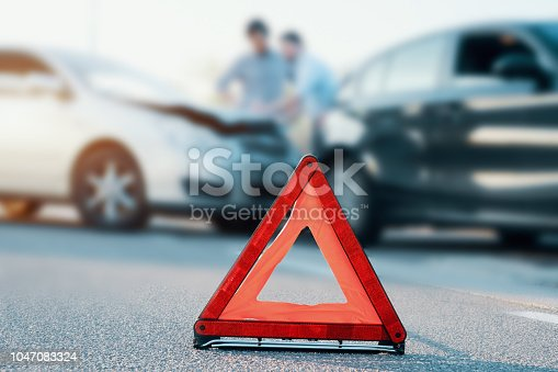 istock Two men reporting a car crash for insurance claim 1047083324