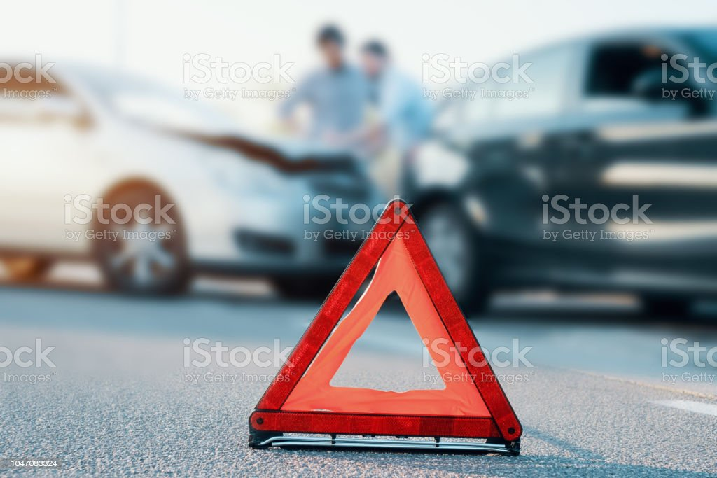 Two men reporting a car crash for insurance claim stock photo