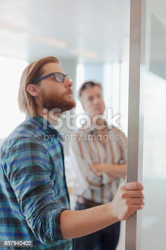 842214626istockphoto Two men reviewing layout diagrams in design planning office 637940402