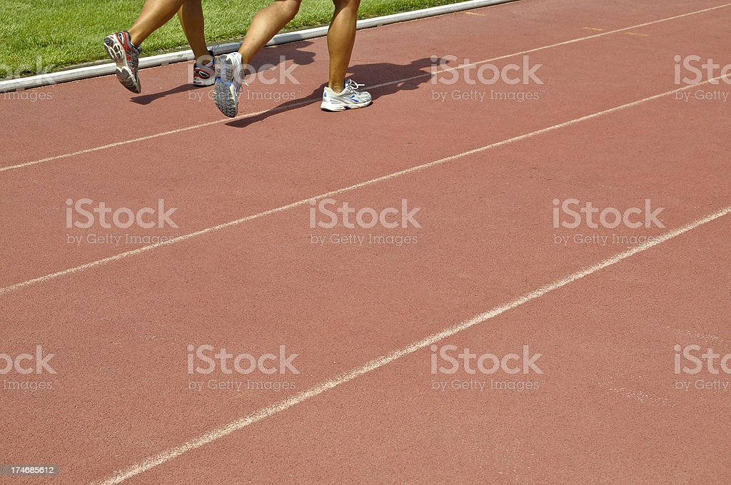 Two Men Running on Athletics Track stock photo