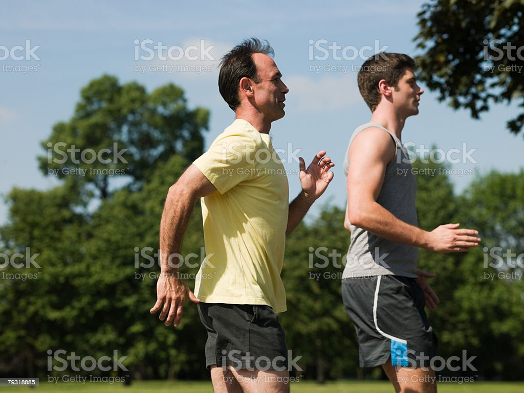 Two men running 免版稅 stock photo
