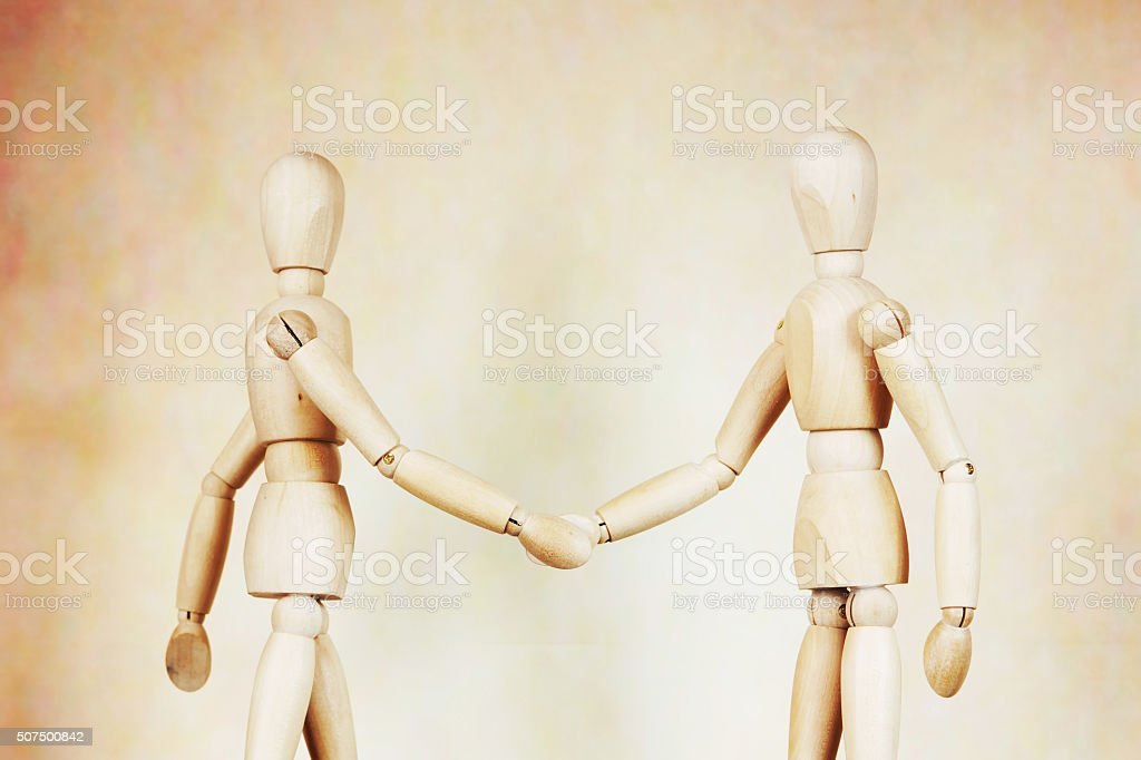 Two men shake hands to each other stock photo