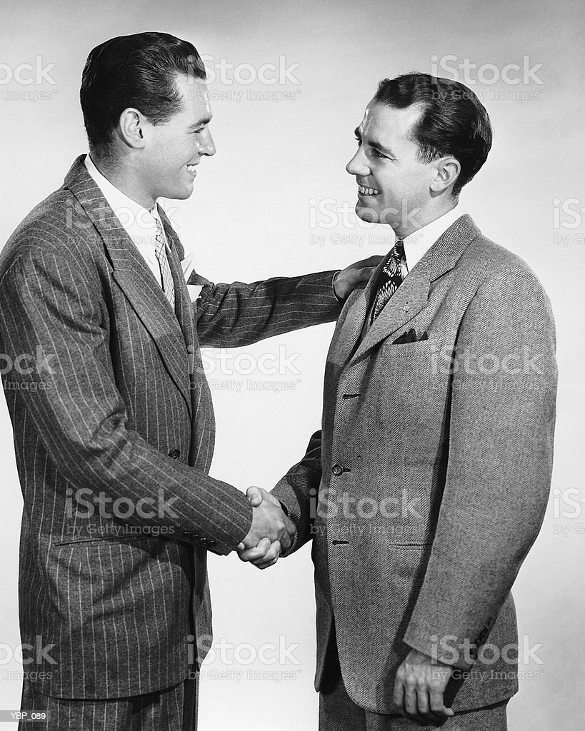 Two men shaking hands royalty-free stock photo