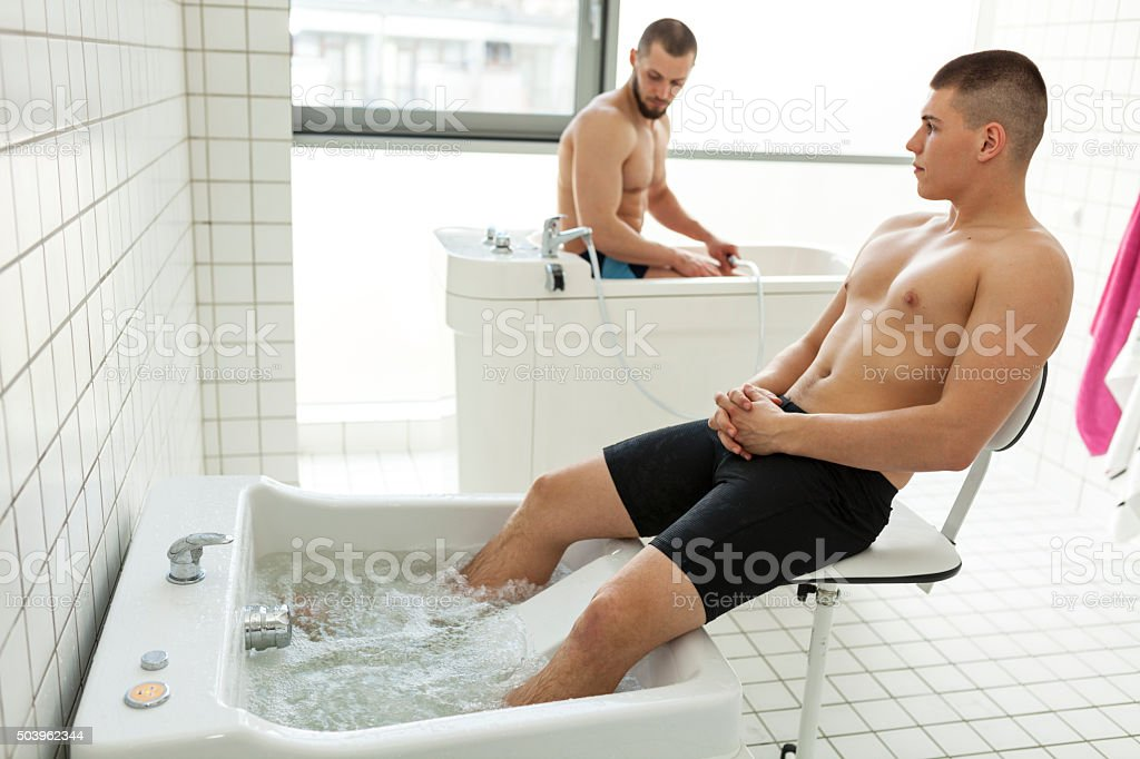 Two Men Sitting In Hydromassage Tubs stock photo