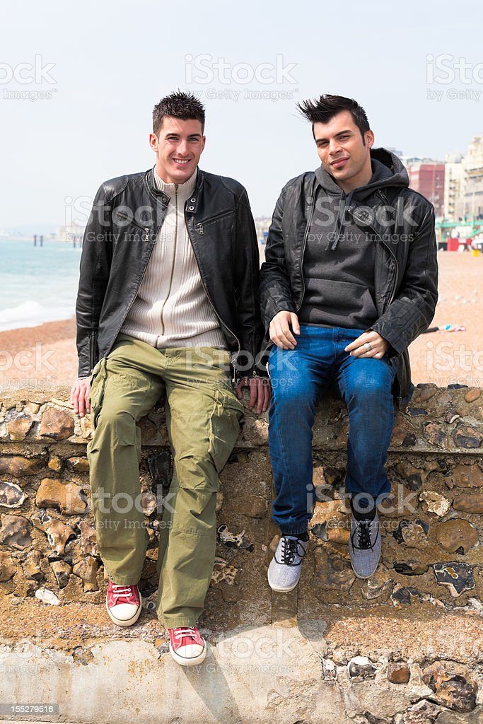 Two Men Sitting Outdoor royalty-free stock photo