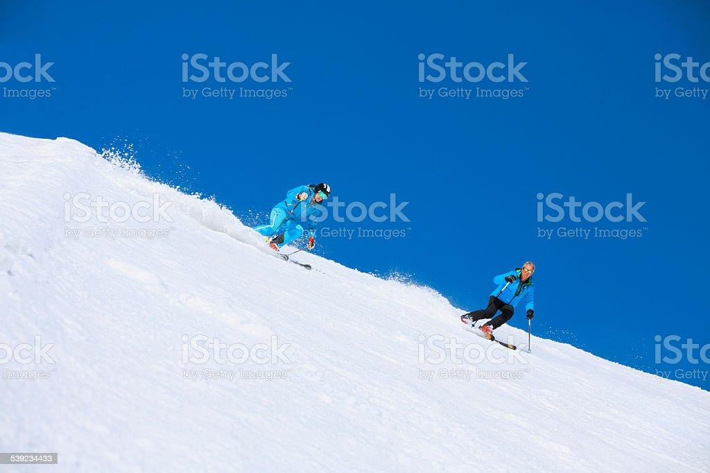 Two Men snow skier skiing   Enjoying on sunny ski resorts royalty-free stock photo