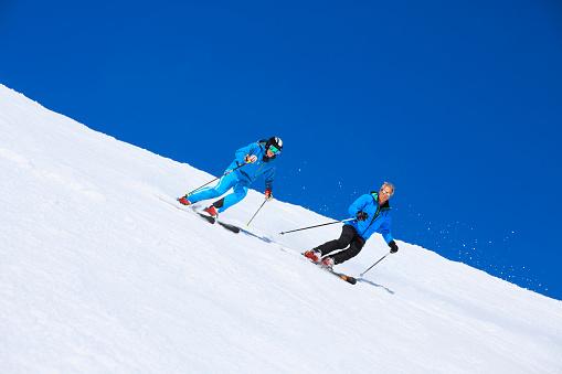 Two Men snow skier skiing   Enjoying on sunny ski resorts