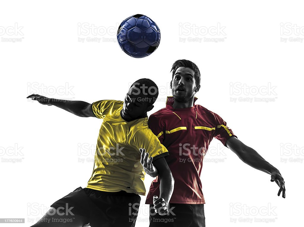 two men soccer players fighting ball silhouette stock photo