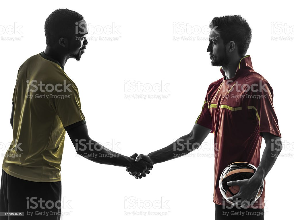 two men soccer players  handshake handshaking silhouette stock photo
