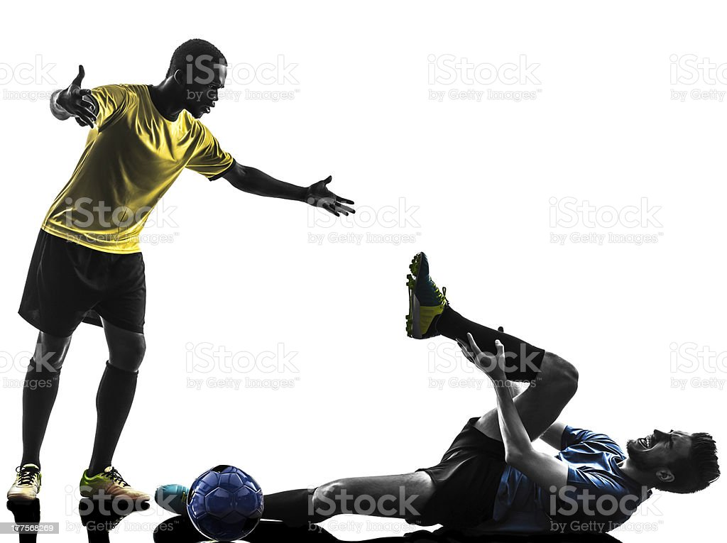 two men soccer players standing complaining foul silhouette stock photo