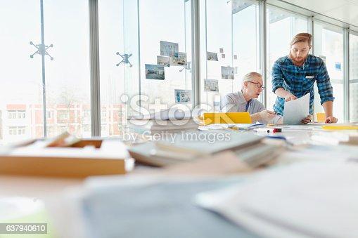 istock Two men talking about ideas in office planning studio 637940610