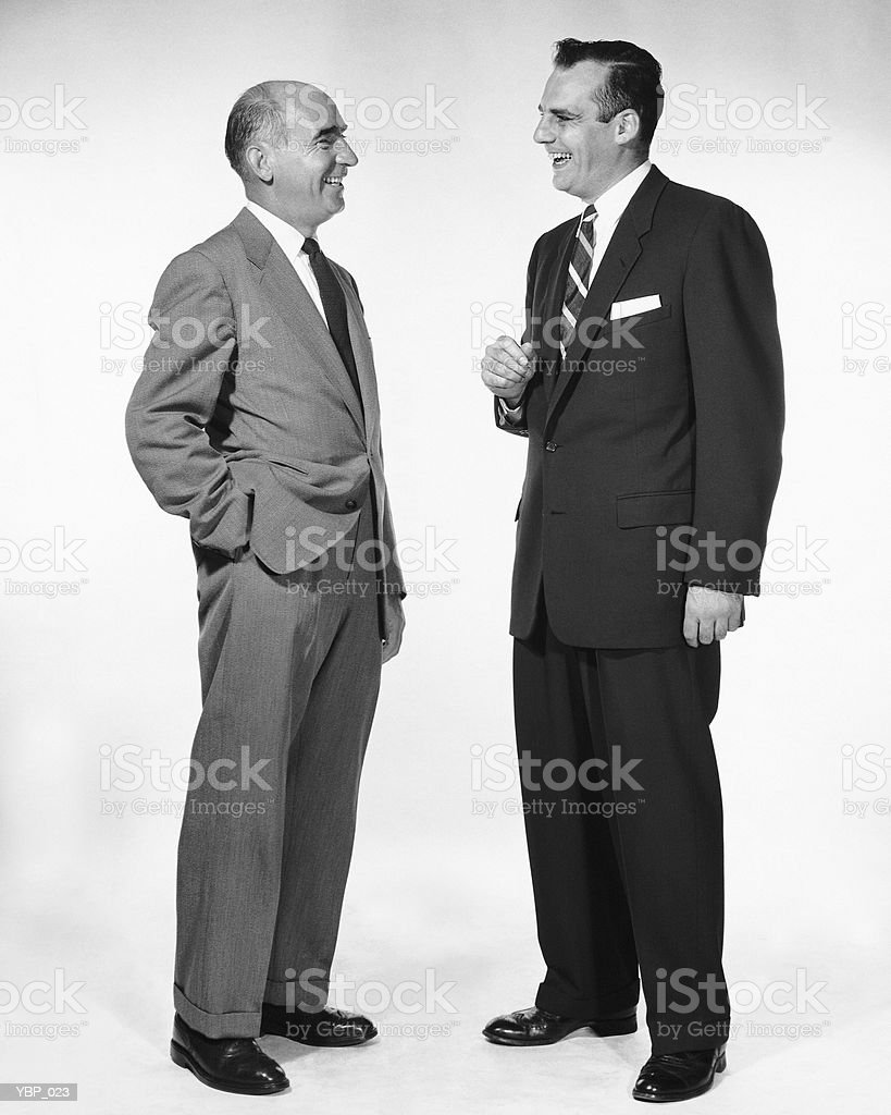 Two men talking and laughing royalty free stockfoto