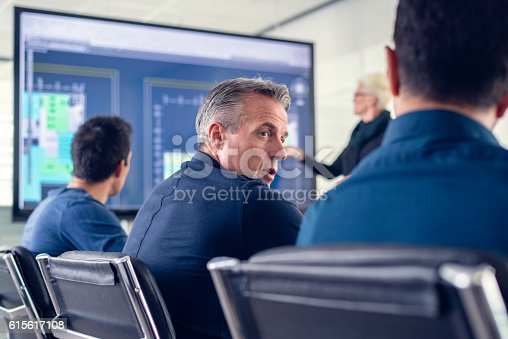 615617034 istock photo Two men talking at an architecture seminar 615617108