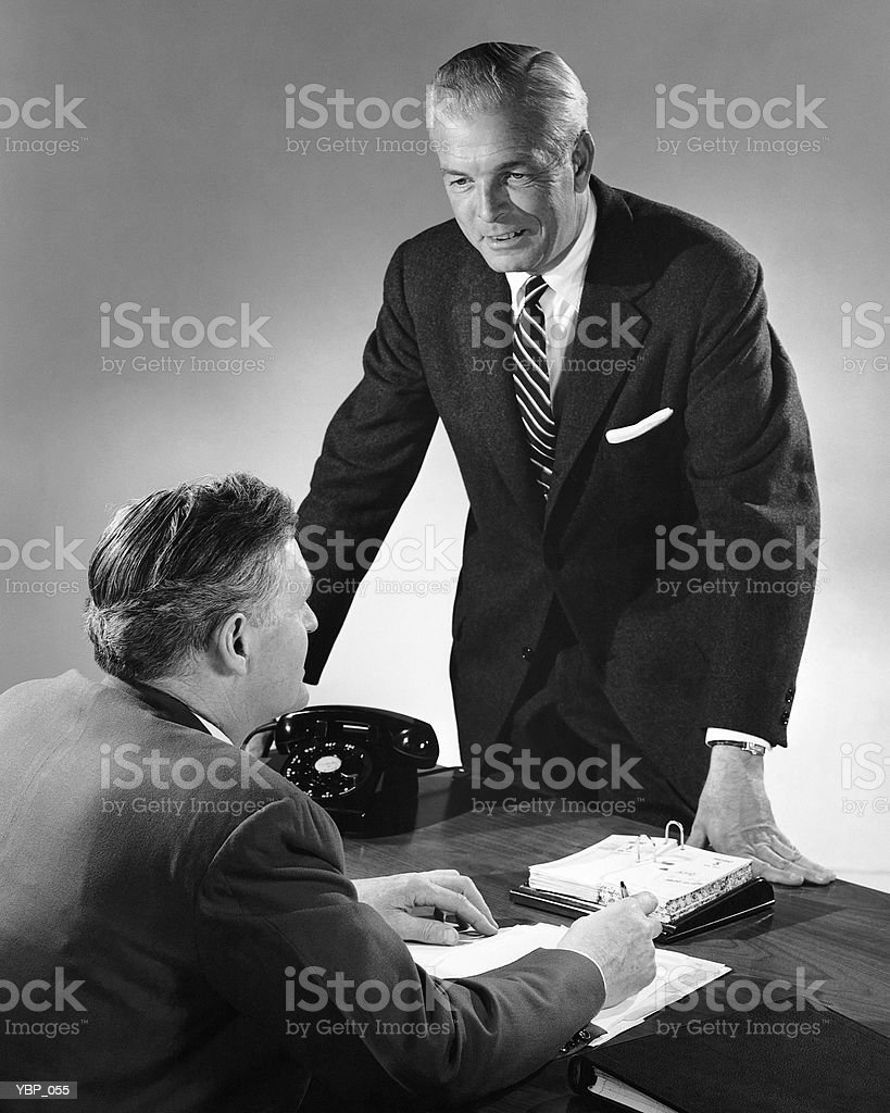 Two men talking royalty free stockfoto