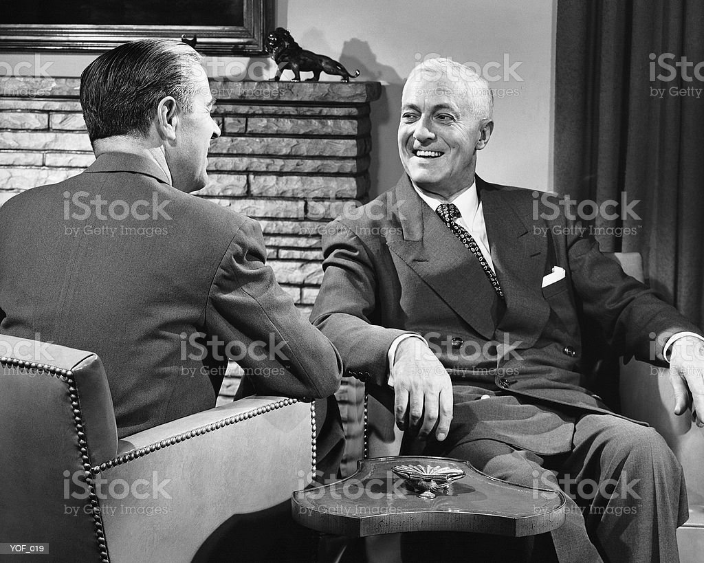 Two men talking royalty-free stock photo