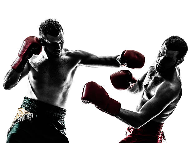 two men thai boxing, one punching - combat sport stock pictures, royalty-free photos & images