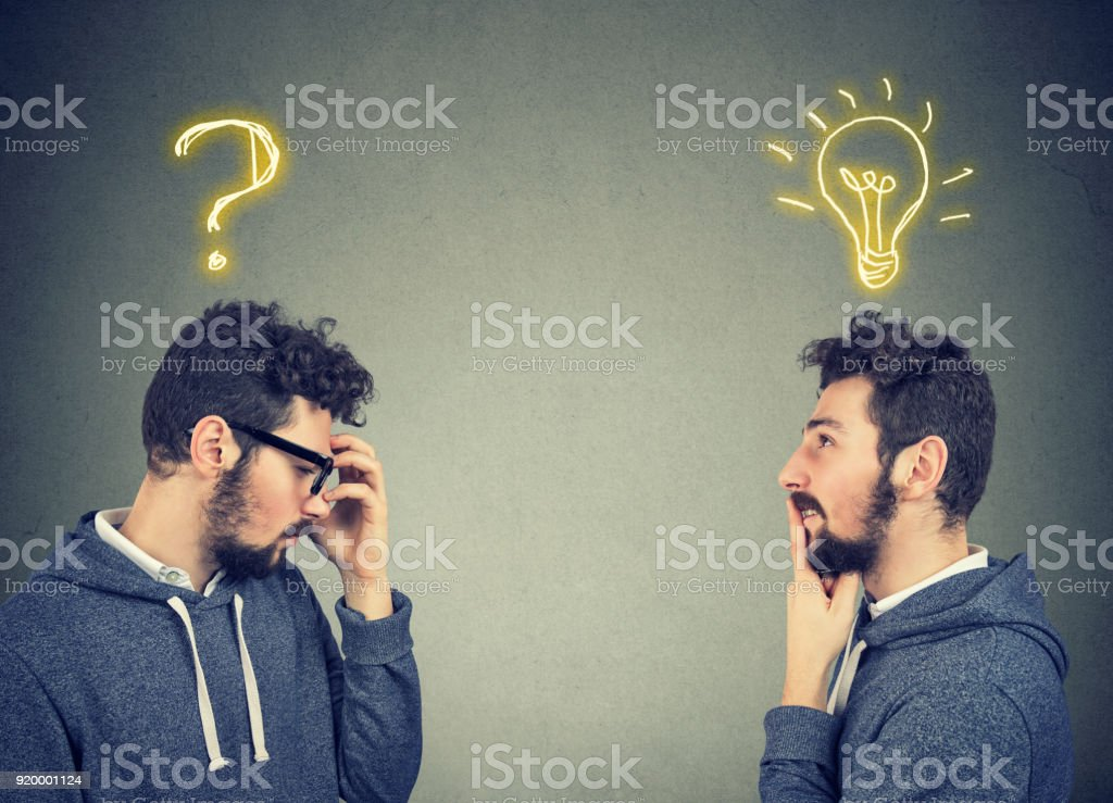 Two men thinking one has a question another solution with light bulb above head stock photo