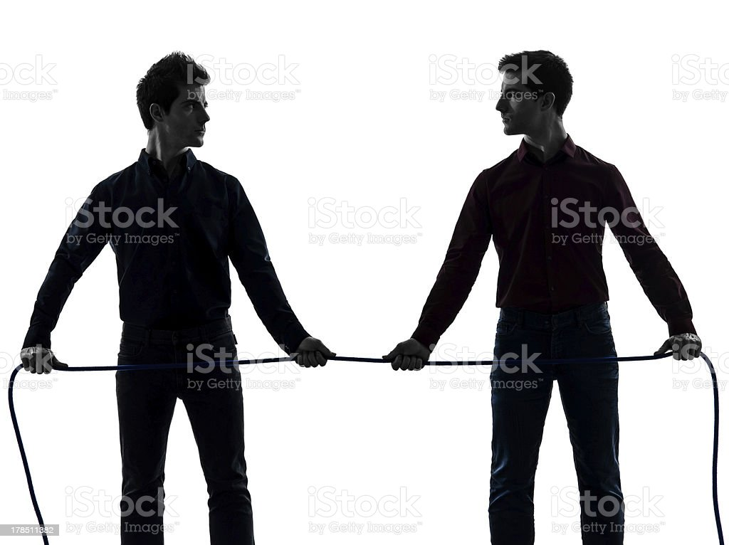 two men twin brother friends tug of war silhouette royalty-free stock photo
