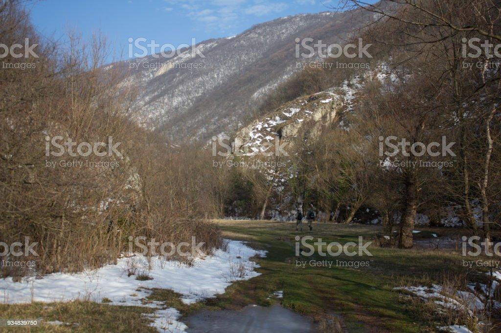 Two men walk through the valley, stock photo