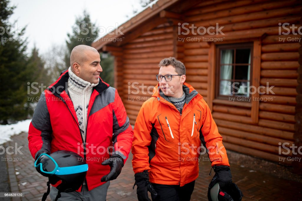 Two Men Walking in the Snow royalty-free stock photo