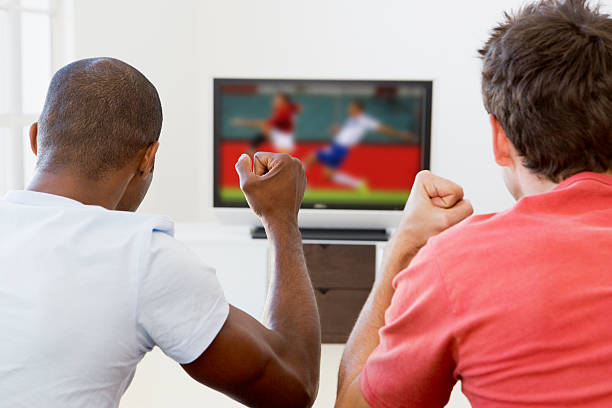 Two men watching television  man cave couch stock pictures, royalty-free photos & images