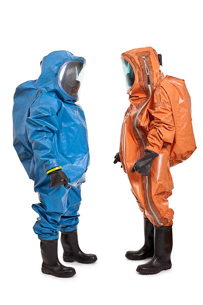 two men wearing chemical protection suit two men wearing chemical protection suit isolated on white protective suit stock pictures, royalty-free photos & images