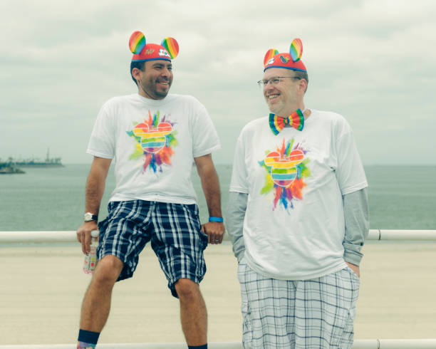 Two men wearing rainbow mickey mouse ears and a matching rainbow picture id985966606?b=1&k=6&m=985966606&s=612x612&w=0&h=1529odc8fldpj1mhkzz0ac9so2adxhphvip7h  rjpm=
