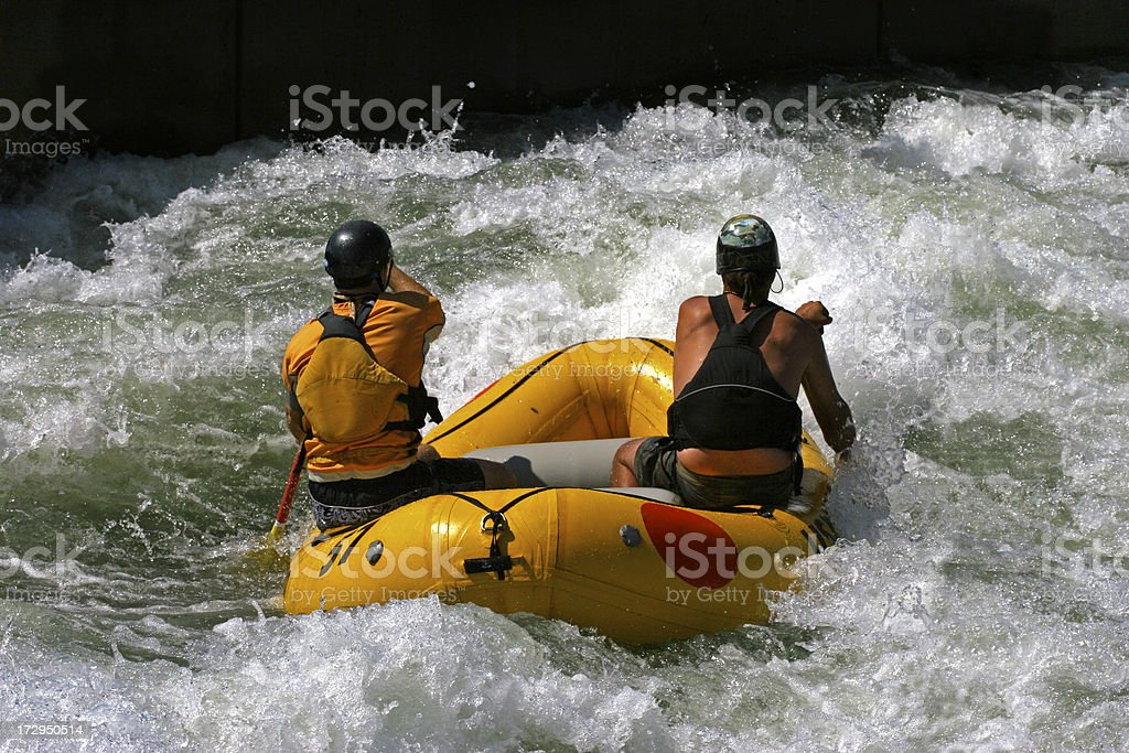 Two men white water rafting stock photo