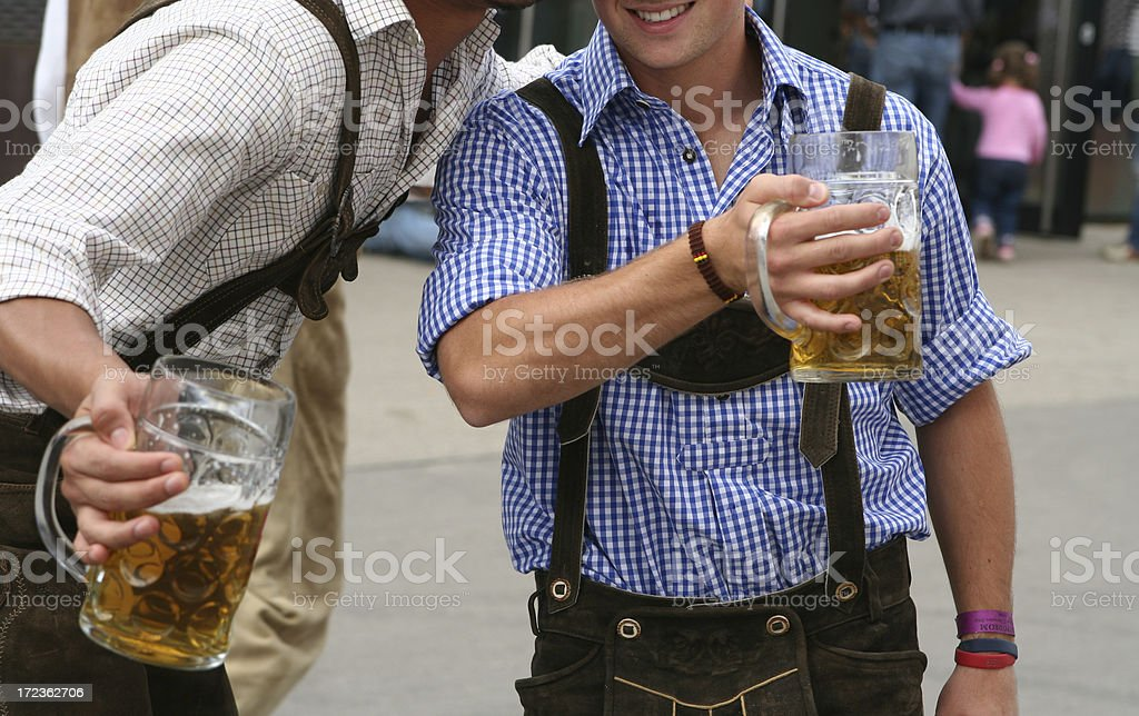 Two men with beer mug at the Octoberfest in Munich royalty-free stock photo