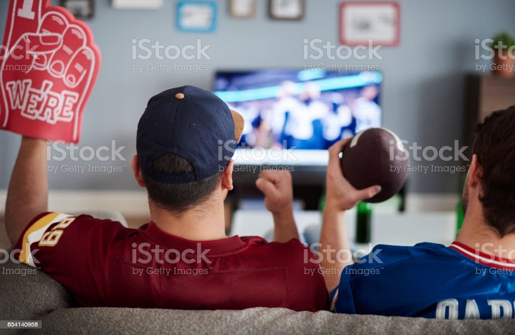 Two men with foam hand and baseball equipment stock photo
