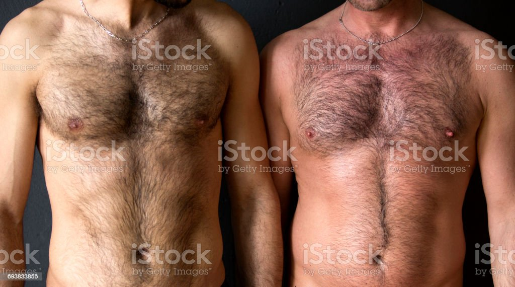 two men with naked chest standing together stock photo