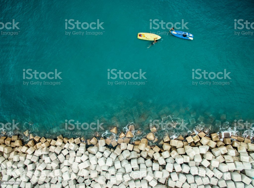 Two men with surfboards stock photo