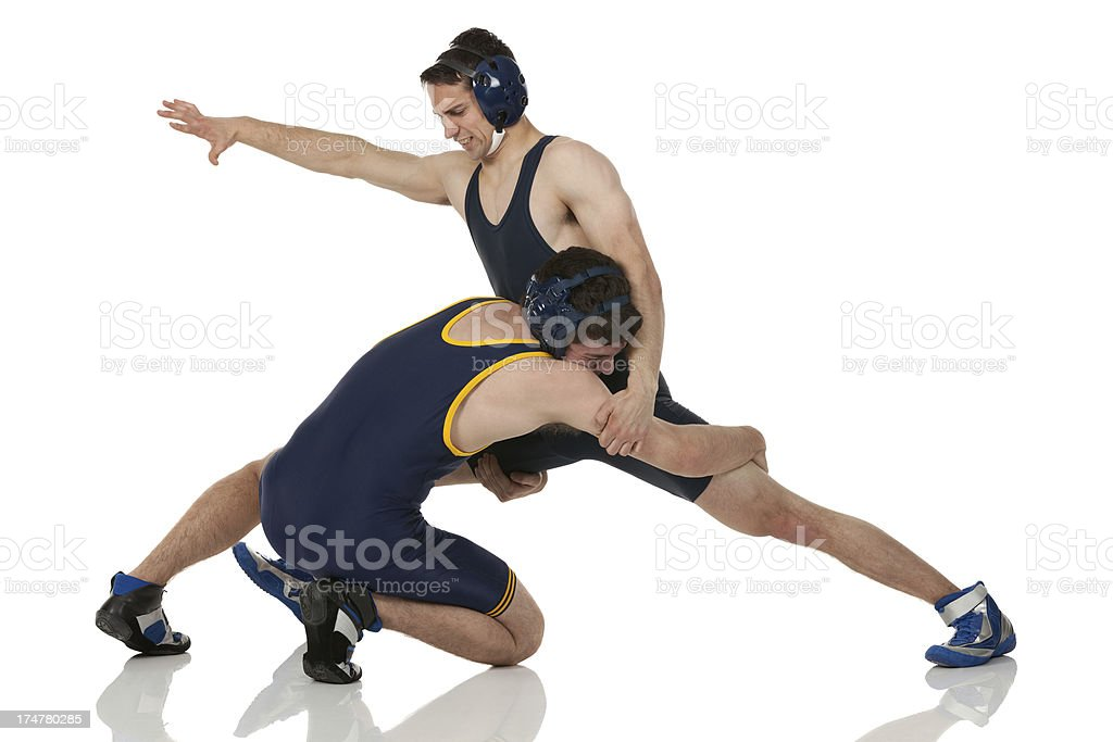 Two men wrestling royalty-free stock photo